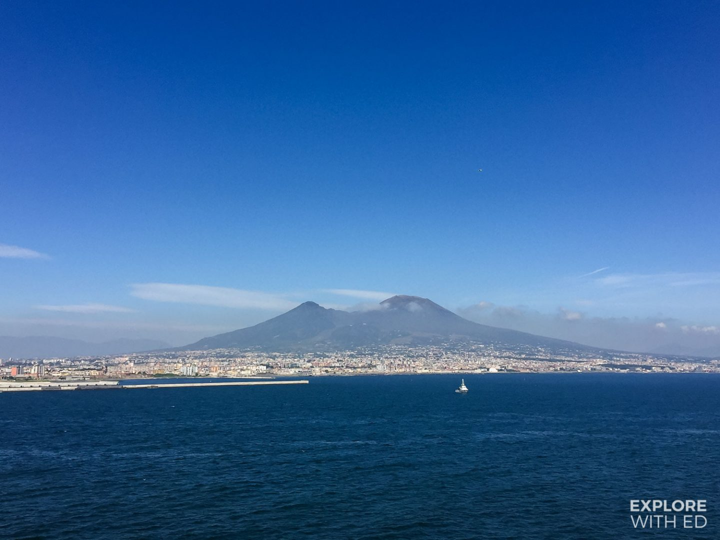 Approaching the port of Naples on a cruise ship with a view of Mount Vesuvius