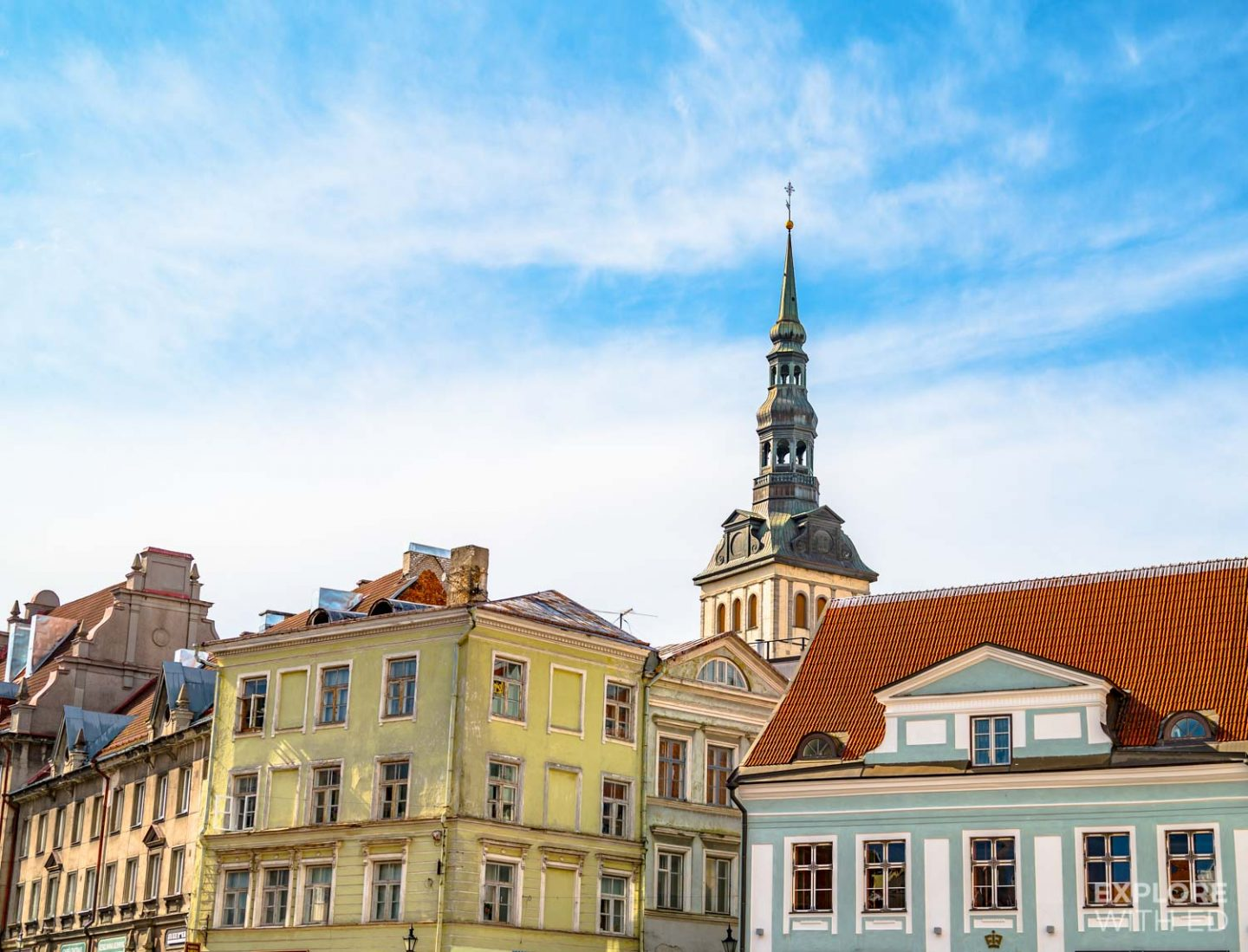 Characterful buildings line Tallinn's Old Town Square, backed by enchanting church spires.